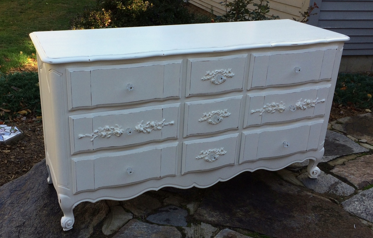 Nine drawer dresser painted white with roses